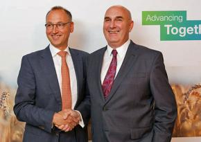 Bayer CEO Werner Baumann (left) greets his Monsanto counterpart Hugh Grant