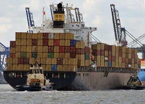 A container ship prepares to dock in New Jersey