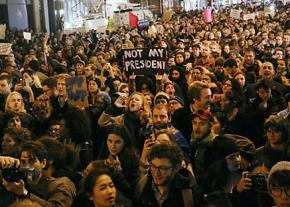 Protesters pour into the streets of Manhattan to fight racism and bigotry after Trump's election