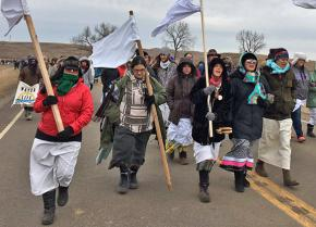 Women from the Oceti Sakowin Camp at Standing Rock march to protect Native sovereignty