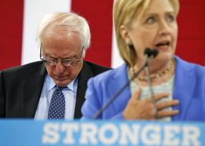 Bernie Sanders waits to endorse Hillary Clinton at a New Hampshire rally