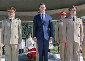Syrian dictator Bashar al-Assad surrounded by his generals