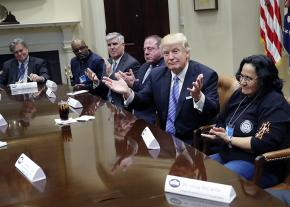 Donald Trump and White House strategist Steve Bannon (at left) meet with a handful of labor leaders