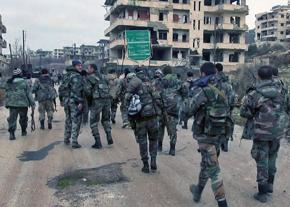 Syrian soldiers march into a conquered city