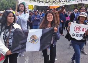 Women workers lead a demonstration against gas price hikes in Mexico City