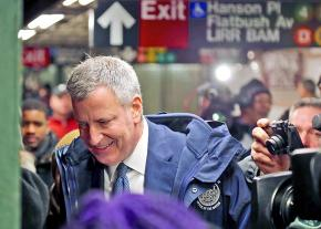 New York City Mayor Bill De Blasio tours the subway in Brooklyn