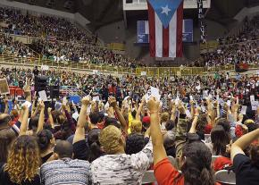 Students delegates vote to strike at a mass meeting in San Juan