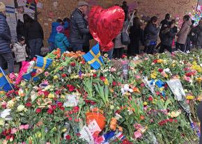 Mourners lay flowers to honor the victims of a terrorist attack in Stockholm