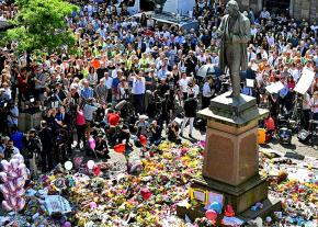 Thousands gather for a vigil in Manchester's St. Ann's Square