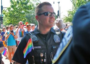 Police officers show support for demonstrators at a pride march in Washington, D.C.