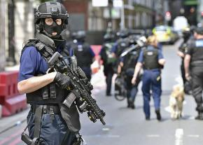 Armed police patrol central London in the aftermath of a terrorist attack