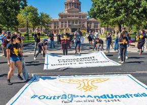 DACA recipients and solidarity activists unfurl banners for a sit-in at the Texas Capitol building