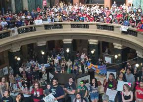 Protesters rally in the Wisconsin state Capitol building to defend DACA