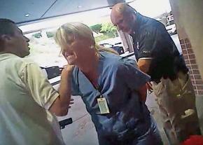 Nurse Alex Wubbels (center) is put under arrest in Salt Lake City