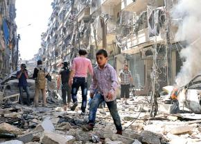 Civilians walk through the devastated streets of Raqqa
