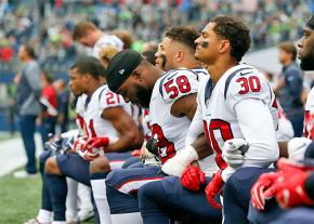 Members of the Houston Texans kneel in protest during the national anthem