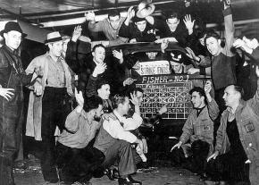 Workers at General Motors celebrate their victory in the Flint sit-down strike