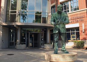 The statue of a social justice icon stands outside the DePaul student center