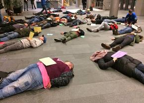 "Activists stage a ""die-in"" in Seattle's City Hall to protest homelessness"
