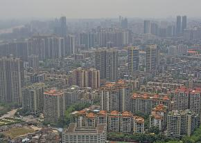 Smog covers the skyline of a working class district in Guangzhou, China