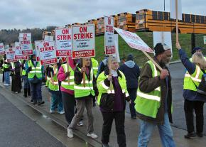 Striking school bus drivers walk the picket line in Seattle, Washington