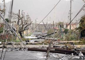 Fallen power lines and debris on the streets of Humacao in Puerto Rico