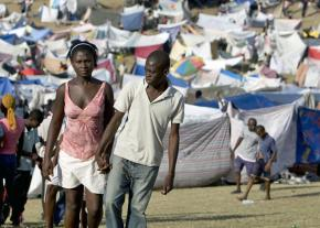Haitians take refuge in a tent camp in the aftermath of the earthquake