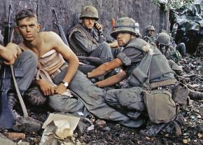 A medic treats a wounded U.S. soldier during the Battle of Huế