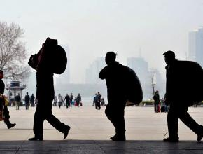Commuting workers arrive at the outskirts of Beijing