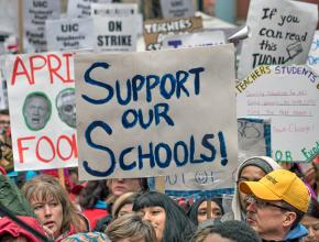 Striking teachers and community members rally to defend public education in Chicago
