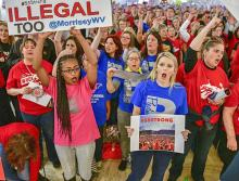 Striking teachers and their supporters stand united in the West Virginia Capitol building
