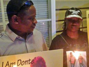Family members hold a vigil for A'Donte Washington in Millbrook, Alabama
