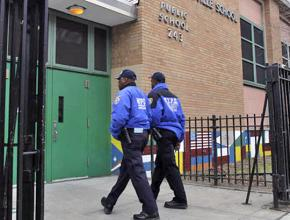 Armed police on patrol at a public elementary school in New York City