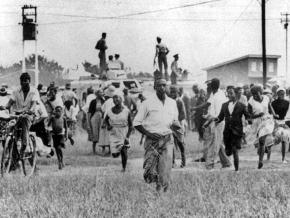 Fleeing police gunfire in Sharpeville, South Africa in 1960