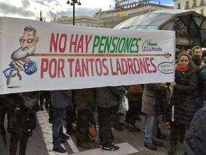 Protesters march against ousted President Mariano Rajoy's pension reforms