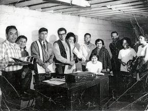 The founding board of the American Indian Movement meets in Minneapolis. Left to right: Harold Goodsky, Charles Deegan, Dennis Banks, Clyde Bellecourt, Peggy Bellcourt, Mr. & Mrs. Barber, Rita Rogers (seated), George Mitchell, Mrs. Mellessy and daughter.