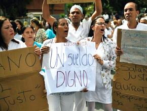 Striking nurses in Caracas demand a fair wage and relief from the crisis