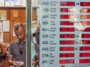 A display board shows the fall in the value of the Turkish lira at a currency exchange in Istanbul