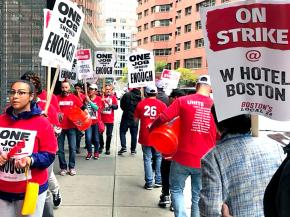 Striking hotel workers walk the picket line in Boston