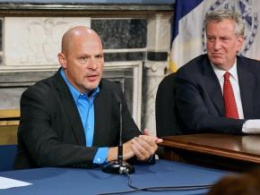 UFT President Michael Mulgrew speaks as Mayor Bill de Blasio looks on
