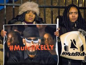 Protesters stand against sexual violence outside R. Kelly's studio in Chicago