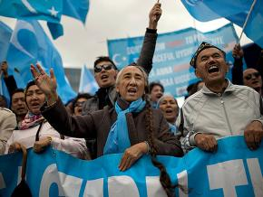 Uyghur protesters demand justice during a demonstration in Brussels