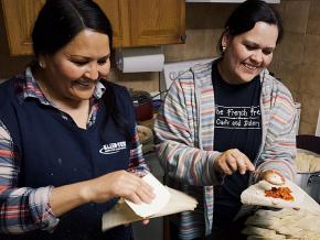 Ginny Calderon (right) and Ceci Mejia prepare tamales for striking teachers in Denver