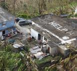 Families in distress call for help in the mountains of Puerto Rico (Kris Grogan | Wikimedia Commons)