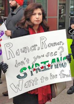 Activists send a message against anti-refugeee bigotry to Gov. Bruce Rauner (Pat Freeman)