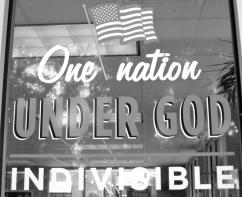A storefront window painted with the American flag (George Landon)