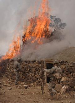U.S. soldiers burn down a house suspected of being used by the Taliban (Staff Sgt. Justin Holley)