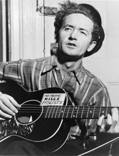 Woody Guthrie, photographed in 1943 (Al Aumuller)