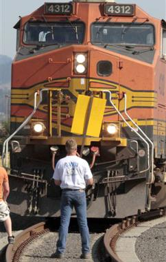 ILWU members block the path of a train outside Longview