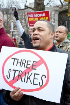 Protesters in Boston oppose the new three strikes law